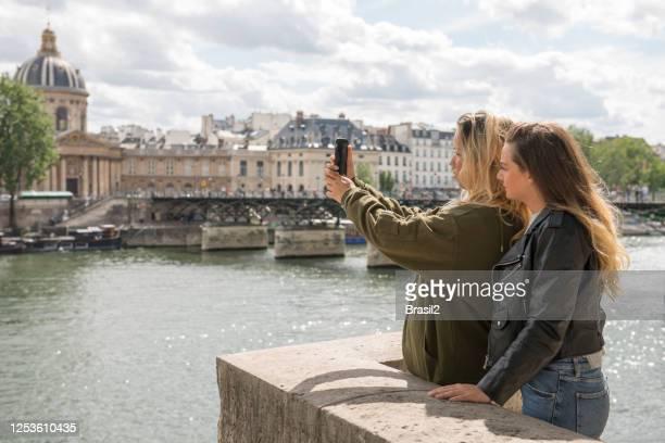 friends in paris taking selfie - paris france stock pictures, royalty-free photos & images