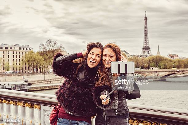 Friends in Paris taking selfie