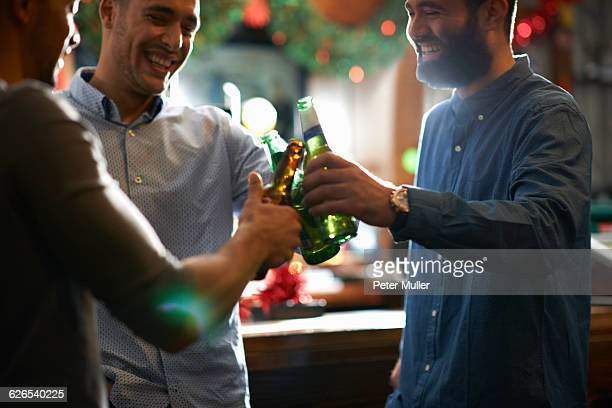 friends in public house making a toast - drink stock pictures, royalty-free photos & images