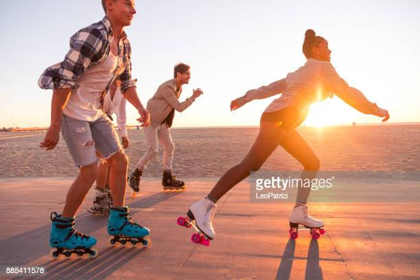 friends in santa monica - los angeles having fun on the promenade - roller skating stock photos and pictures