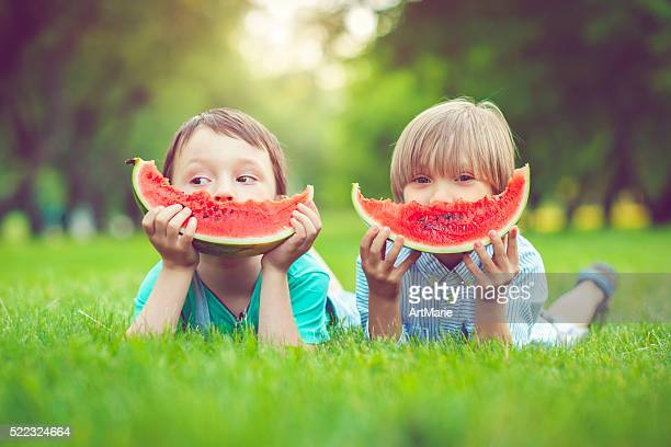 friends in summer - watermelon stock pictures, royalty-free photos & images