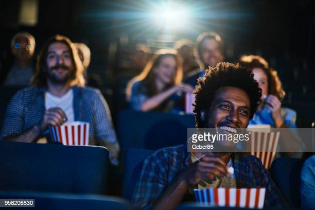 friends in the cinema - film screening stock pictures, royalty-free photos & images