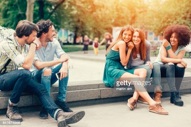 friends in the city park - next to stock pictures, royalty-free photos & images