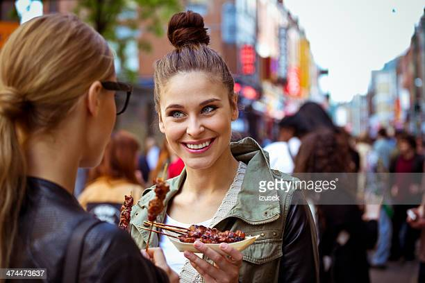 friends in the city - street food stock photos and pictures