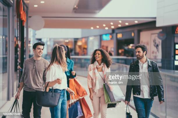 friends in the mall - shopping mall stock pictures, royalty-free photos & images