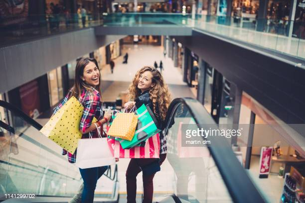 friends in the shopping mall - shopping centre stock pictures, royalty-free photos & images