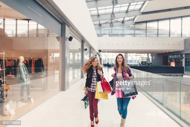 friends in the shopping mall - shopping centre stock photos and pictures