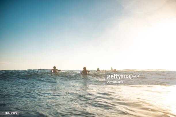 Friends in the water getting ready to surf