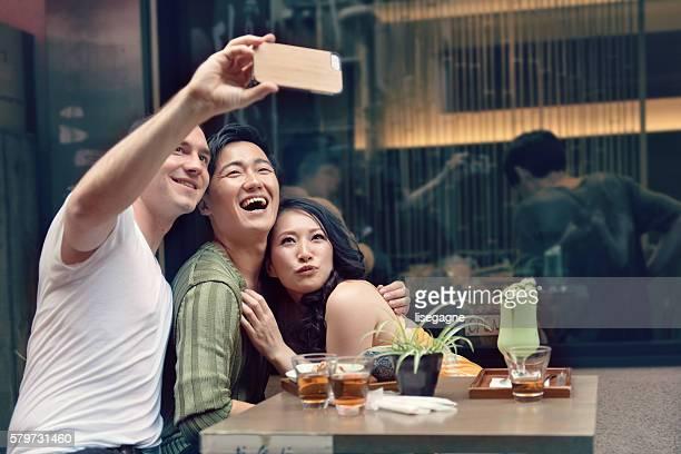Friends in Tokyo taking selfie