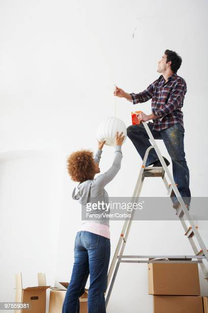 Friends installing light