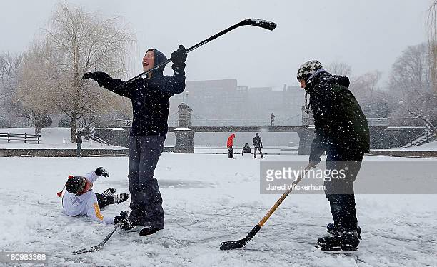 Friends Jackson Greeley Andreas Frank and Louis Lapsley play a game of ice hockey on the frozen duck pond in Boston Common on February 9 2013 in...