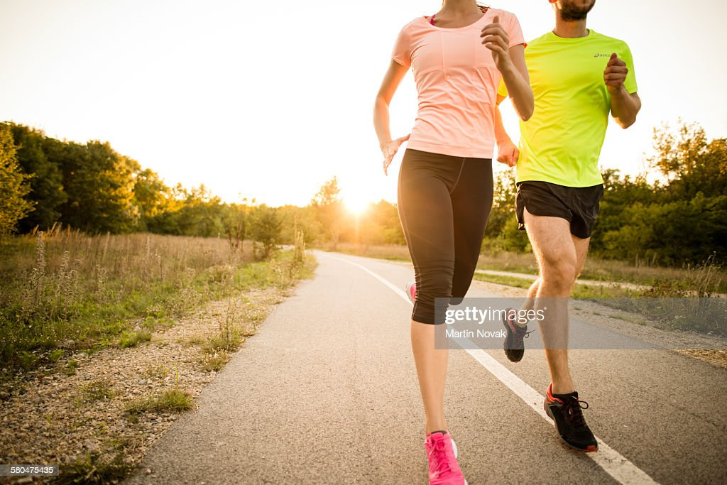 Friends jogging at sunset : Stock Photo