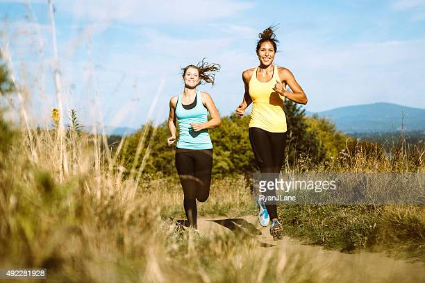 friends jogging in nature area - cross country running stock pictures, royalty-free photos & images