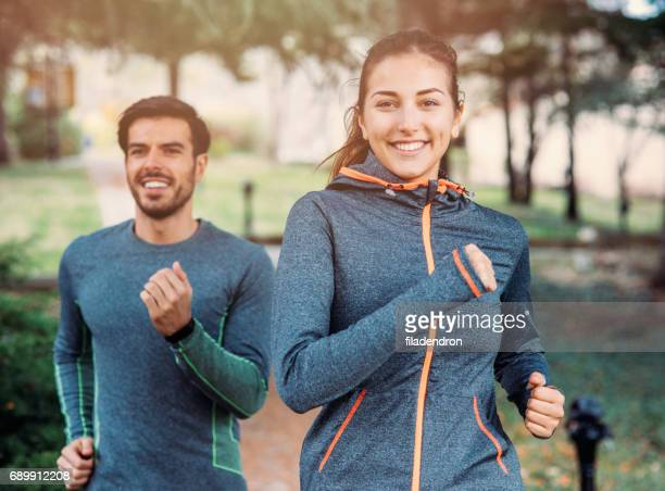 friends jogging in the park - jogging stock pictures, royalty-free photos & images