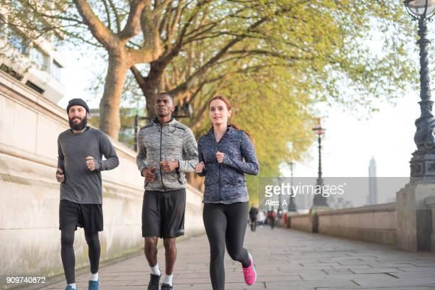 Friends jogging on promenade