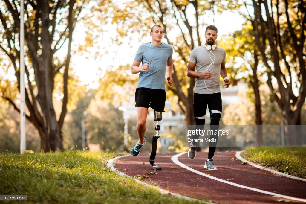Friends jogging outdoors : Stock Photo