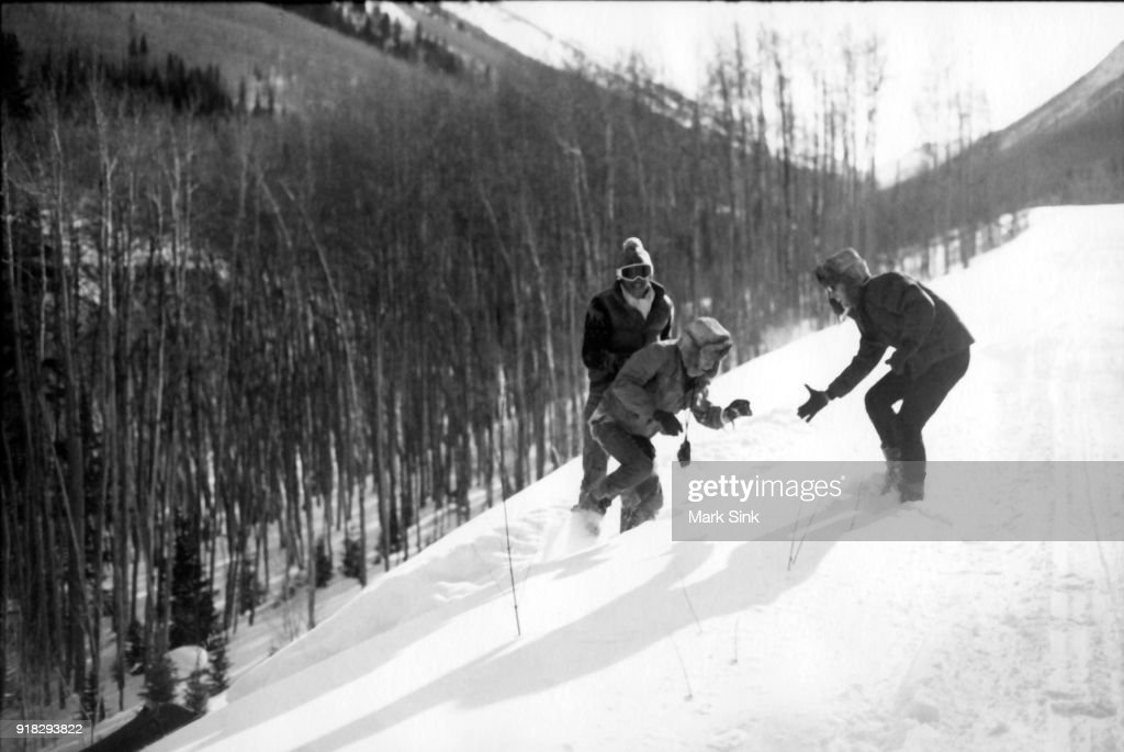 Friends Jon Gould and Chris Makos helping Andy Warhol get up the embankment after a snowmobile crash documented in 'The Andy Warhol Diaries' on new year's day, January 1, 1983 in Aspen, Colorado.