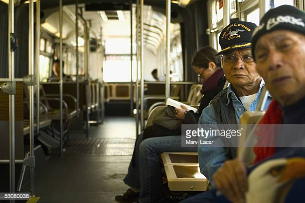 Friends Jose Recto and Epifanio Topaz sit on a bus headed to the Veterans Affairs Medical Center in Ft Miley May 9 2005 in San Francisco The two...