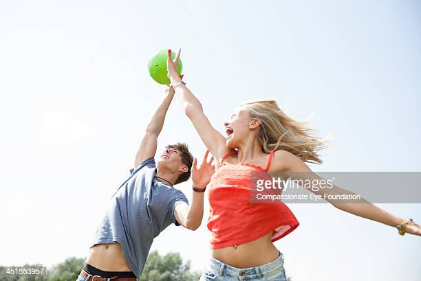 Friends jumping for ball
