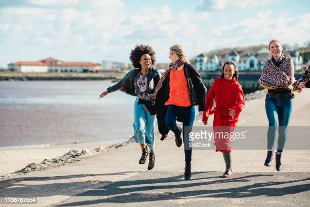 friends jumping for joy - travelstock44 stock pictures, royalty-free photos & images
