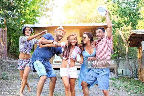 Friends jumping in front of veranda