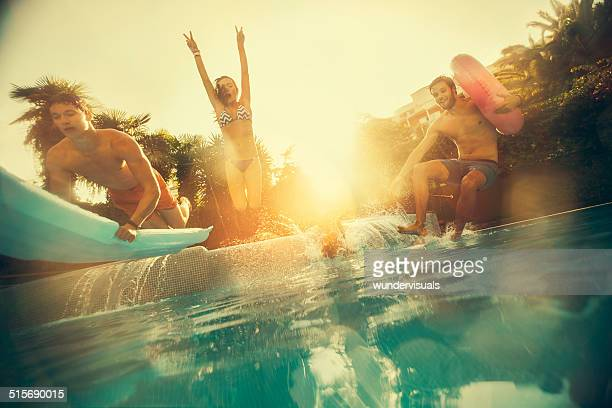 Friends Jumping in Swimming Pool