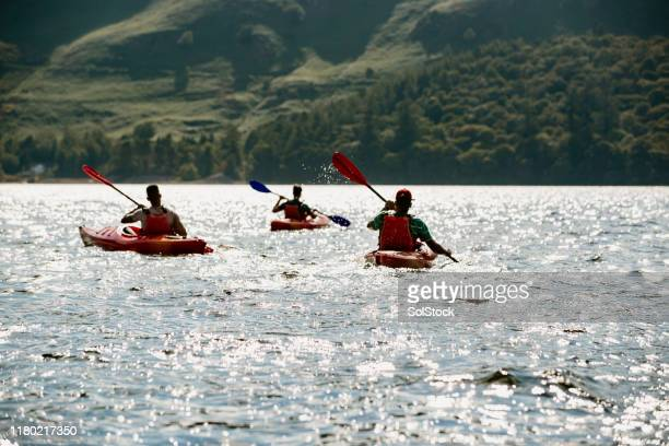 friends kayaking on derwent water - adventure stock pictures, royalty-free photos & images