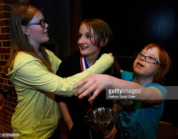 Colorado state spelling bee stock photos and pictures getty images friends kimmy neel right and emily seale left greet sylvie lamontagne who has won the spelling m4hsunfo