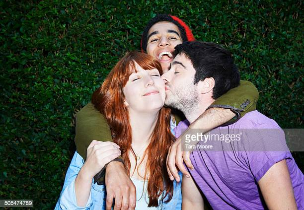 friends kissing - three people stock pictures, royalty-free photos & images