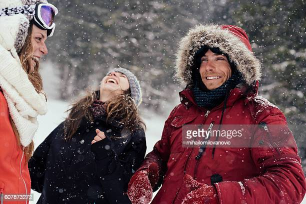 friends laughing and enjoying the winter time - parka coat stock photos and pictures