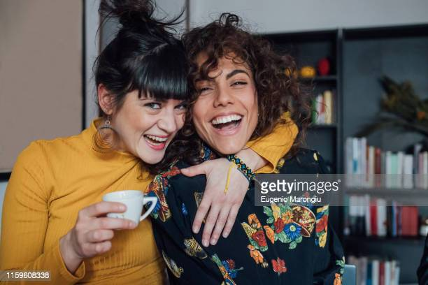 friends laughing and making faces - female friendship stock pictures, royalty-free photos & images