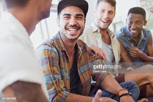 Friends laughing and relaxing indoors