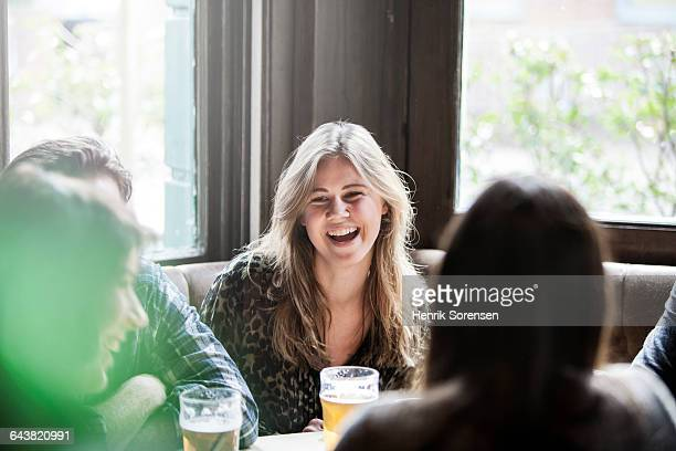 Friends laughing at a pub