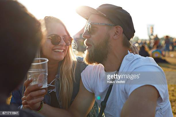 Friends laughing at big festival concert