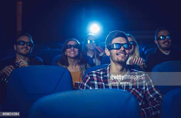 Friends laughing at the comedy movie