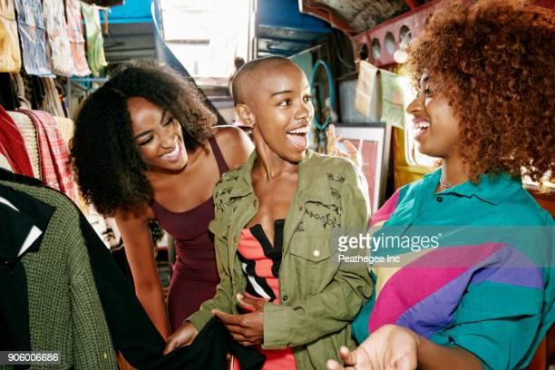 friends laughing in retail store on bus - cabeza afeitada fotografías e imágenes de stock