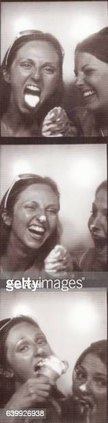 Friends Laughing Inside Photo Booth