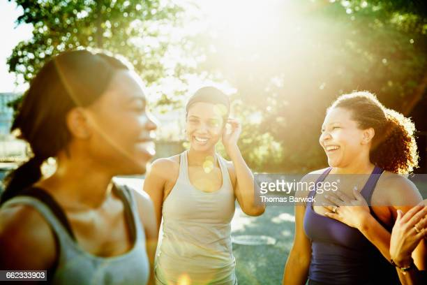Friends laughing together after morning run