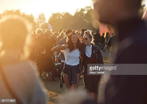 friends laughing together at big festival - festival musicale foto e immagini stock
