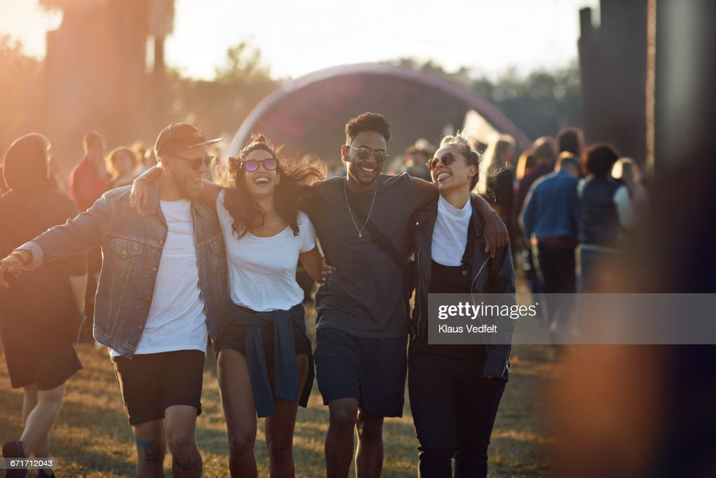 Friends laughing together at big festival : Stock Photo
