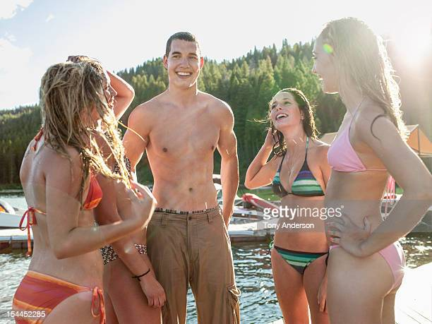 Friends laughing together at mountain lake