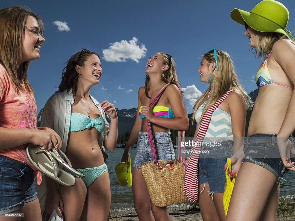Friends laughing together at the beach : Stock Photo