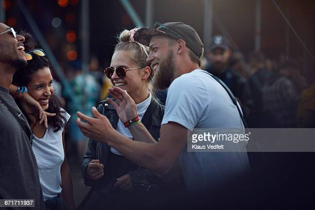 friends laughing together & clapping at concert - festival or friendship not school not business stock photos and pictures