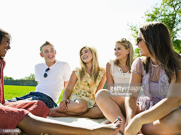 friends laughing together in park - teenagers only stock pictures, royalty-free photos & images