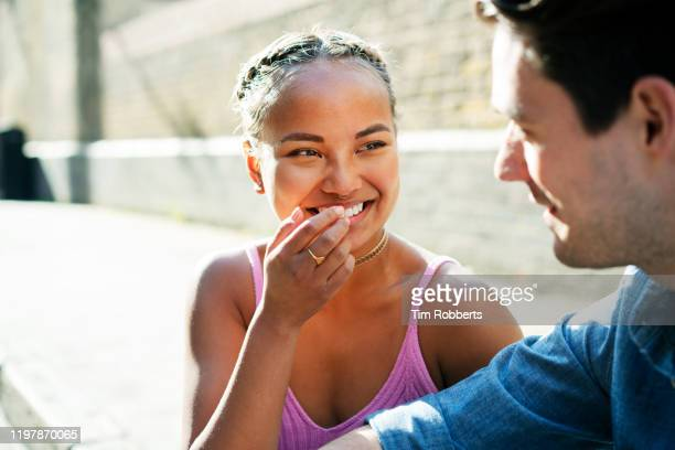 friends laughing together on street - discussion stock pictures, royalty-free photos & images