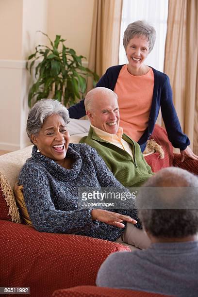 friends laughing together - heterosexual couple photos stock photos and pictures