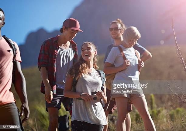 Friends laughing while trekking in the mountains