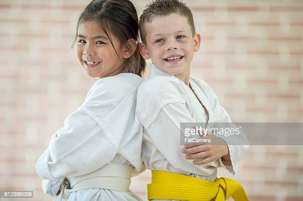 friends learning martial arts - taekwondo kids stock photos and pictures