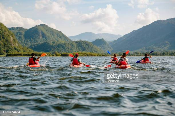 friends learning to kayak - cumbria stock pictures, royalty-free photos & images