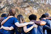 Friends linking arms in unity